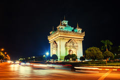 Vientiane, Laos. Patuxay park at night with illuminated Gate of Victory Royalty Free Stock Photography