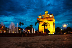 Vientiane, Laos. Patuxay park at night with illuminated Gate of Victory Royalty Free Stock Photo