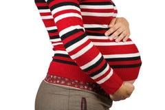 Vientre de 9 meses de mujer embarazada Imágenes de archivo libres de regalías