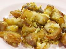 Vientre de cerdo frito con ajo y sal Imagen de archivo