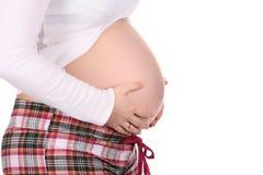 Vientre de la explotación agrícola de la mujer embarazada Foto de archivo