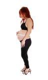 Vientre de medición de la mujer embarazada Imagen de archivo libre de regalías