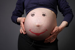 Vientre embarazado Fotografía de archivo libre de regalías
