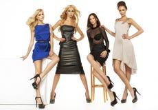 Vier aantrekkelijke vrouwelijke modellen samen royalty-vrije stock afbeeldingen