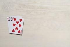 vier acht Spielkarten auf hellem Schreibtisch Lizenzfreie Stockbilder
