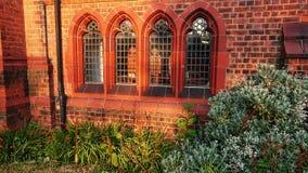 Vier alte Buntglaskirchenfenster lizenzfreies stockfoto