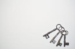 Vier antike Schlüssel Stockbilder