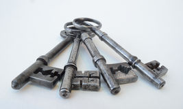 Vier antike Schlüssel Stockfotos