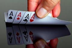 Vier Asse in der Hand Lizenzfreie Stockfotos