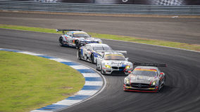 Vier Autos am Renntag SuperGT ringsum 7 2014 in Burirum, Thailand Lizenzfreie Stockfotos