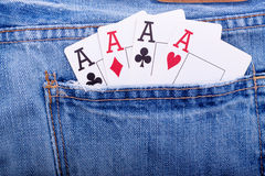 Vier azen in jeanszak royalty-vrije stock foto's