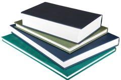 Vier Bücher auf weißem Hintergrund Lizenzfreie Stockfotos