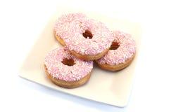Vier Bevroren Doughnuts met bestrooit Royalty-vrije Stock Fotografie