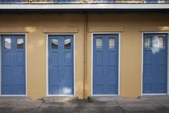 Vier blaue Türen Stockbild
