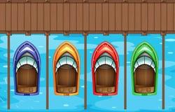 Vier Boote, die am Pier parken Lizenzfreies Stockfoto