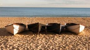 Vier boten op het strand Stock Fotografie
