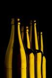 Vier braune Flaschen Lizenzfreie Stockfotos