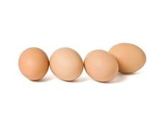 Vier bruine eieren Stock Afbeelding