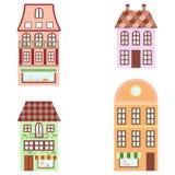 Vier bunte alte Häuser Lizenzfreies Stockfoto