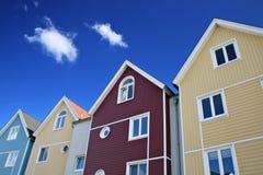Vier bunte Häuser Stockfoto