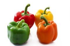 Vier bunte Paprika stockfotografie