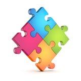 Vier bunte Stücke des Puzzlespiels (Laubsäge) Stockfotos