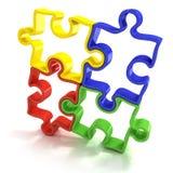 Vier bunte umrissene Puzzlestücke, mit einem Band versehen Stockfotografie