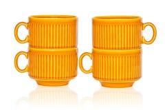 Vier ceramische koffiekoppen die op wit worden geïsoleerdb Royalty-vrije Stock Foto