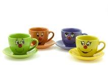 Vier Cup des Kindes mit neugierigen Gesichtern Stockbild