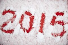 Vier die cijfers in de witte sneeuw worden geschreven Stock Fotografie