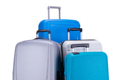Vier die koffers op witte achtergrond worden geïsoleerd Stock Afbeelding