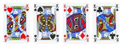 Vier die Koningenspeelkaarten - op wit worden geïsoleerd stock fotografie