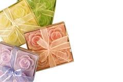Vier dozen met aromakaarsen stock foto