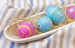 Vier Eier auf der Platte Stockfotografie