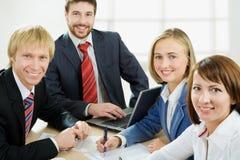 Vier Fachleute Stockfotos