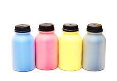 Vier Farbenflaschen eines Lackes Stockbilder