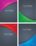 Vier farbige Abdeckungen auf Grau Lizenzfreies Stockbild