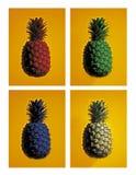 Vier farbige Ananas auf gelbem Hintergrund Stockbild