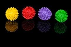 Vier farbige Plastikkugeln Stockfoto
