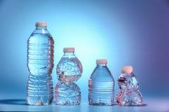 Vier Flaschen Wasser Stockbild