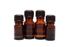 Vier flessen aromatherapy oliën Royalty-vrije Stock Foto's