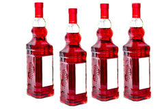 Vier flessen rode wijn Stock Foto
