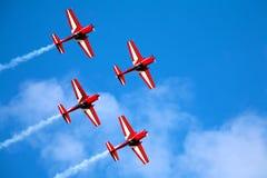 Vier Fluglinien in der Anordnung Lizenzfreie Stockfotos