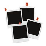 Vier Fotorahmen auf der Wand mit Schatten Lizenzfreie Stockfotografie