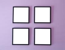 Vier frames op muur Royalty-vrije Stock Afbeeldingen