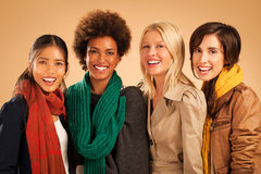 Vier Frauen-Lächeln Lizenzfreie Stockfotografie