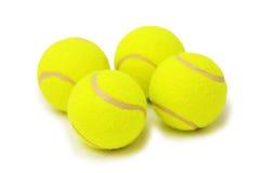 Vier geïsoleerde tennisballen Royalty-vrije Stock Afbeelding