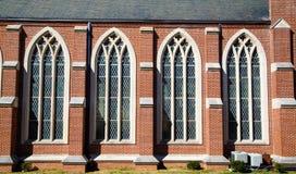 Vier Gebrandschilderde glazenvensters Stock Foto