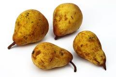 Vier gele peren Royalty-vrije Stock Foto's