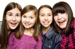 Vier gelukkige en glimlachende jonge meisjes Royalty-vrije Stock Afbeeldingen